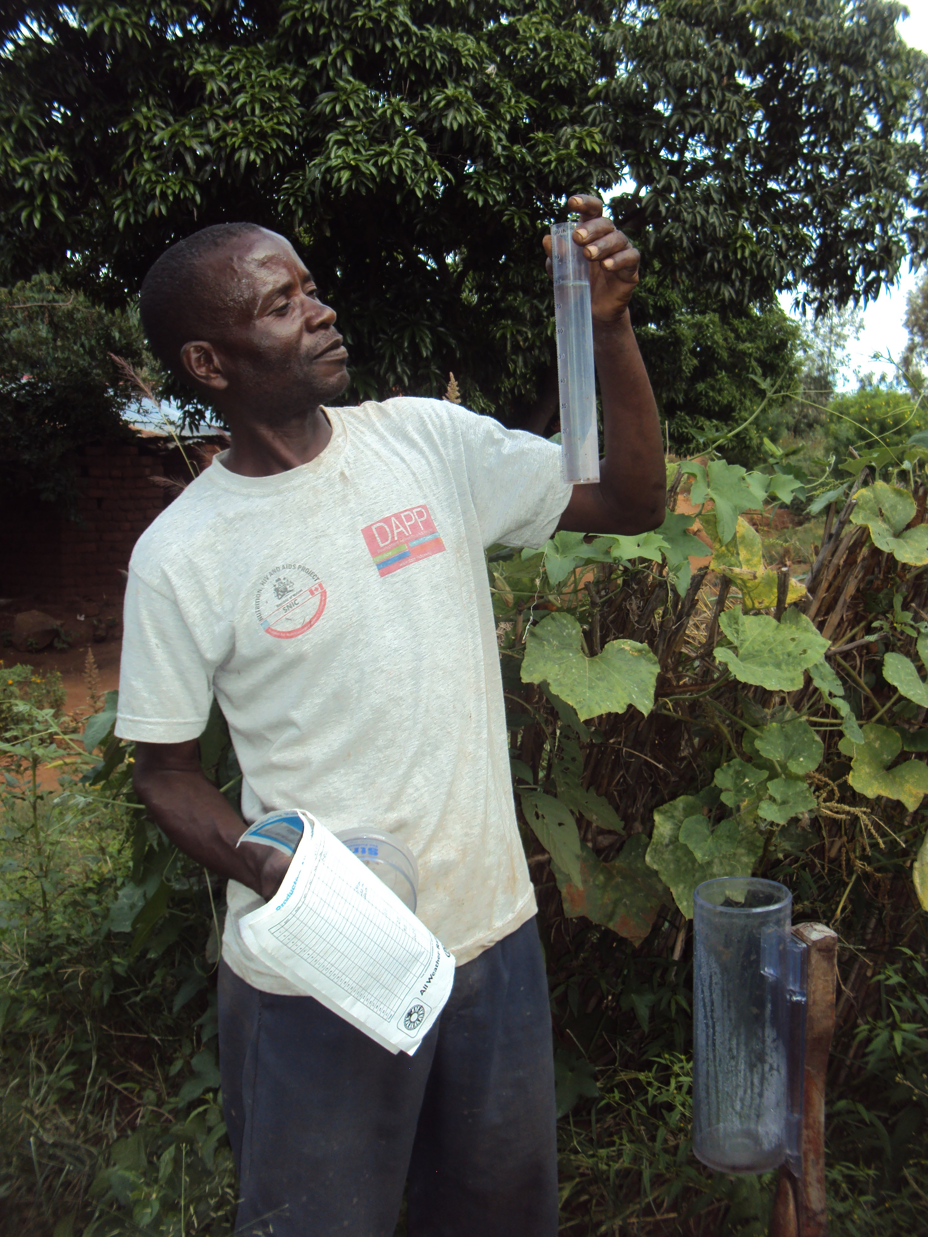 Farmer in Malawi takes rainfall recordings in an effort to combat erratic weather patterns and drought