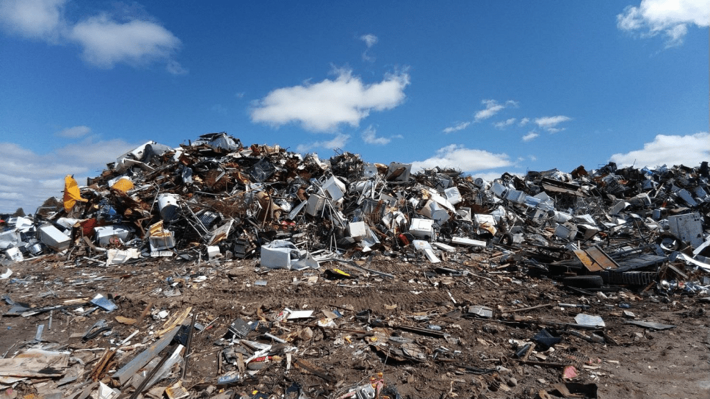 A scrap heap. Paper and other types of waste producing waste gases.